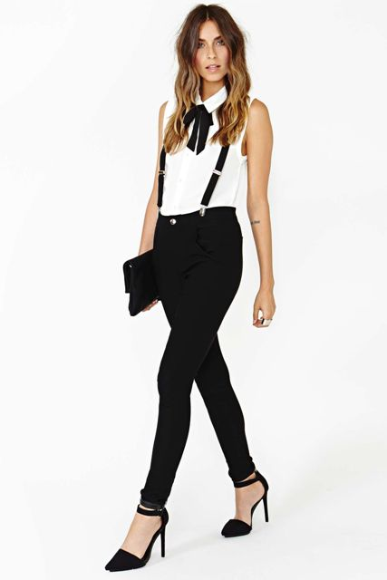 With white sleeveless shirt, black clutch and black ankle strap shoes