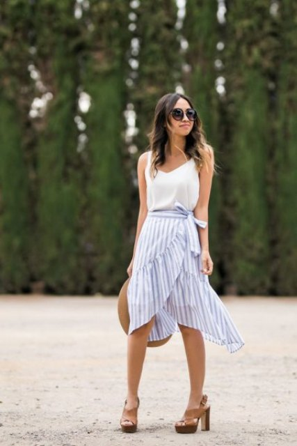 With white sleeveless top, hat and brown platform sandals