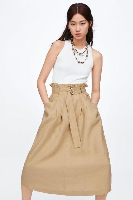 With white sleeveless top