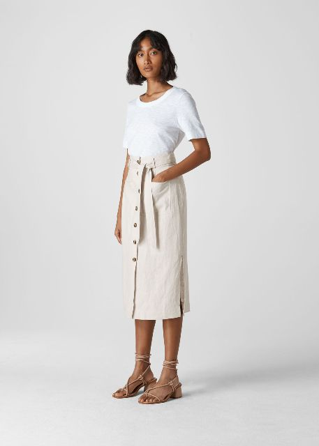 With white t-shirt and beige lace up low heeled sandals