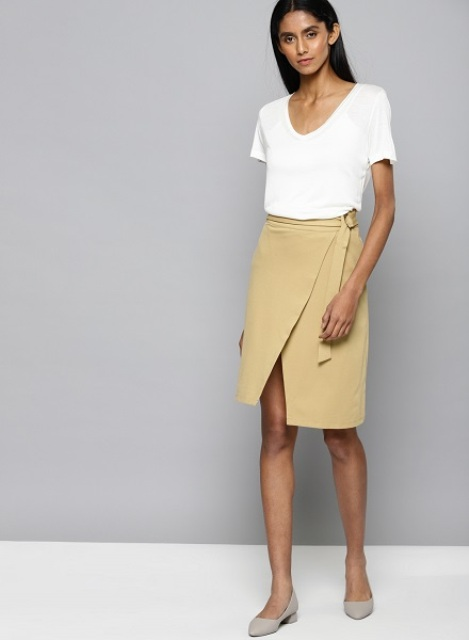 With white t-shirt and gray low heeled shoes