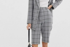 With white t-shirt, black bag, white and light gray sneakers and checked long blazer