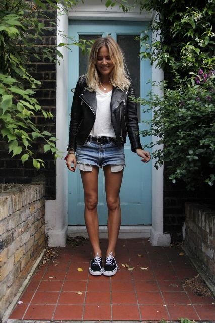 With white t shirt, black leather jacket and black and white sneakers
