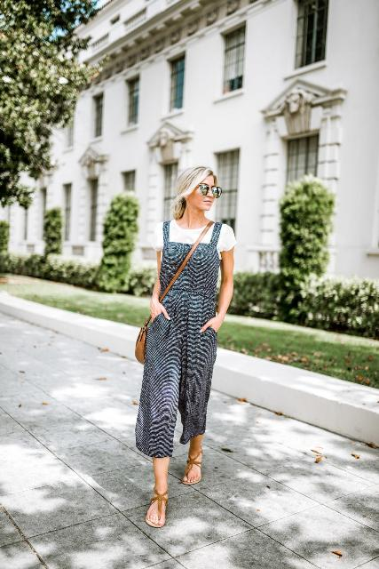 With white t-shirt, brown crossbody bag and brown flat sandals