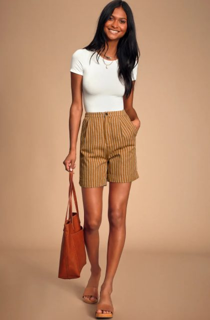 With white t-shirt, brown tote bag and brown sandals