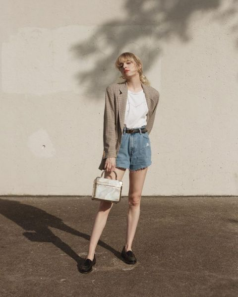 With white t shirt, printed blazer, bag and black flat shoes