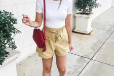 With white t-shirt, red tassel bag and flat sandals