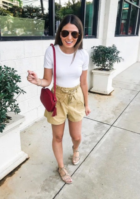 With white t shirt, red tassel bag and flat sandals