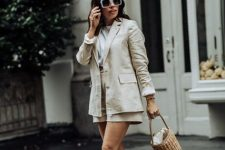 With white t-shirt, straw basket bag and white sneakers