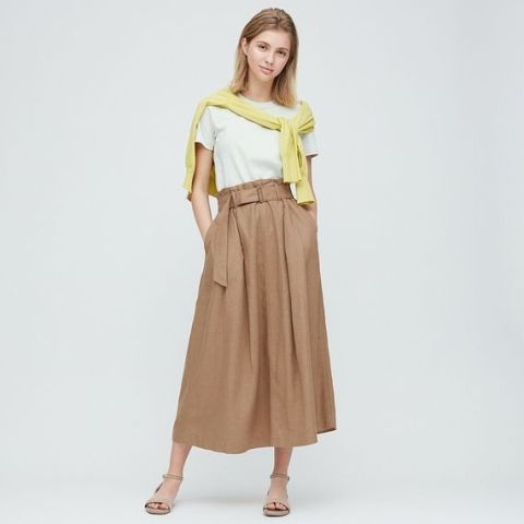 With white t shirt, yellow sweater and beige ankle strap sandals