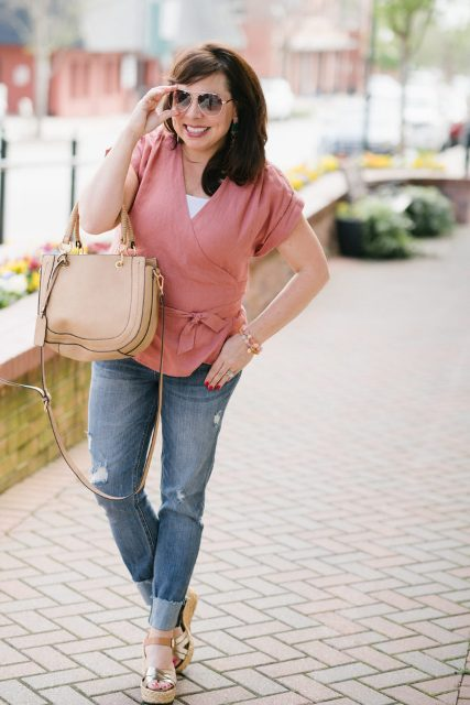 With white top, beige bag, cuffed jeans and silver platform sandals