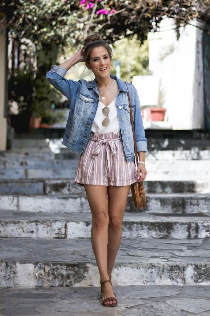 With white top, denim jacket, rounded bag and brown sandals