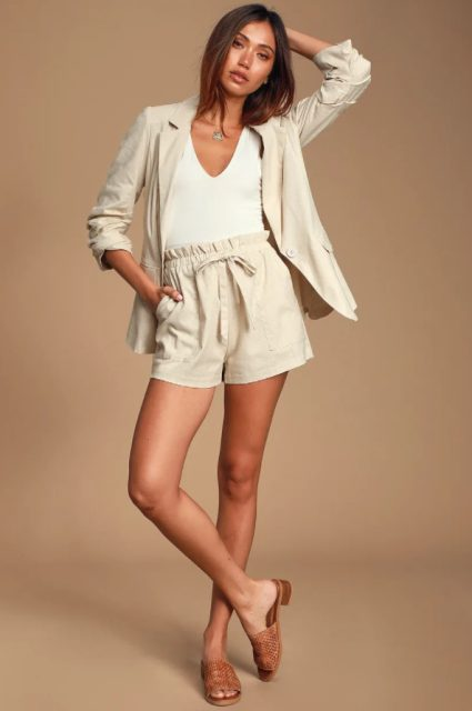 With white top, linen blazer and brown flat sandals