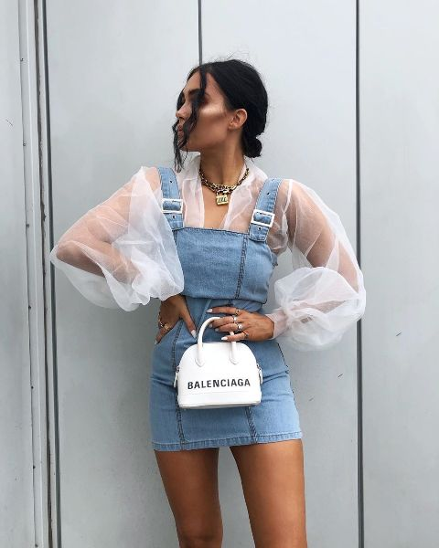 With white transparent blouse and white mini bag