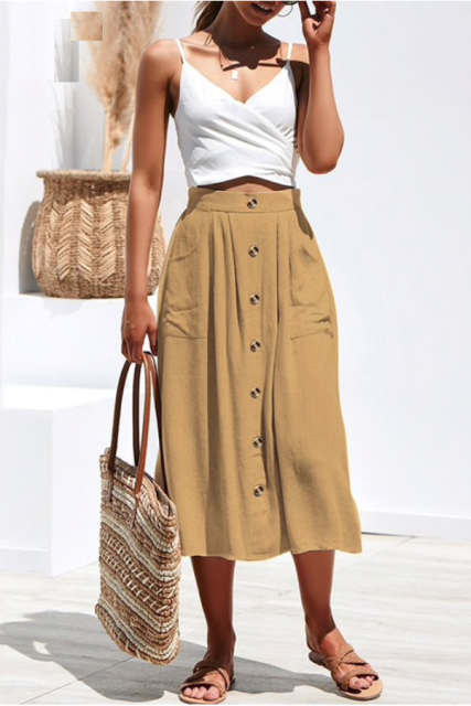With white wrap crop top, tote bag and brown flat sandals