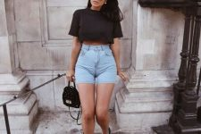 a black cropped t-shirt, blue high waisted denim shorts, black sneakers, a black bag for a sexy summer look