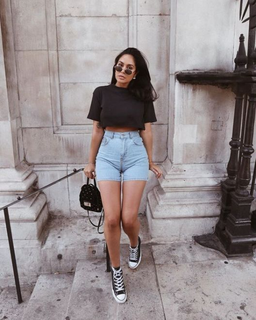 a black cropped t shirt, blue high waisted denim shorts, black sneakers, a black bag for a sexy summer look