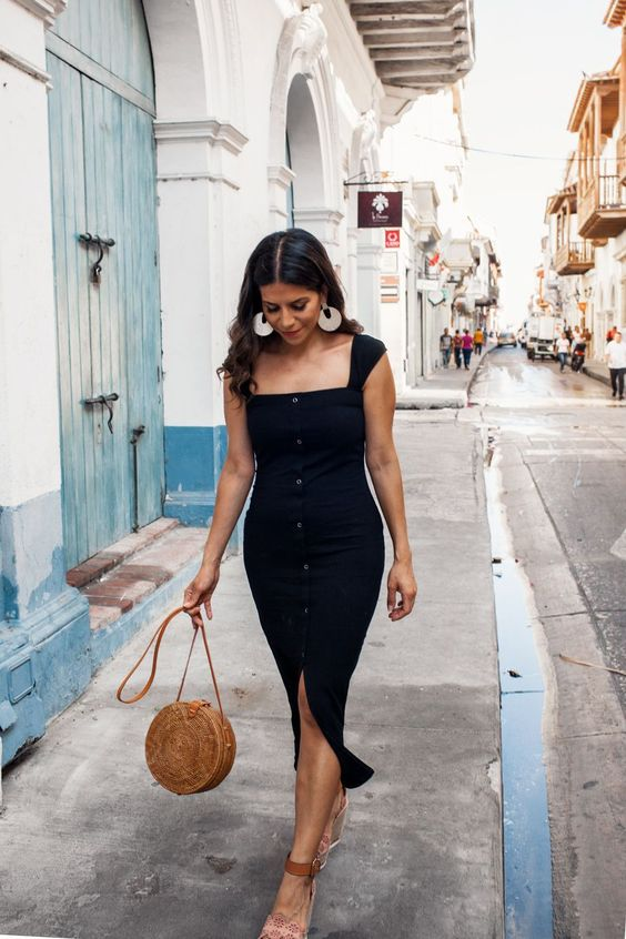 a black fitting button up midi dress with thick straps, a square neckline, espadrilles, and a round bag