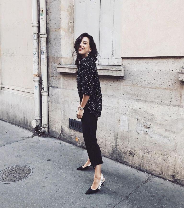 a black polka dot shirt, black cropped jeans, black and white logo slingbacks for a night out