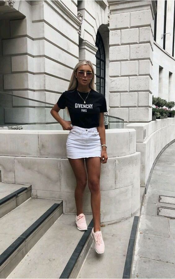 a black printed cropped t shirt, a white denim mini, pink trainers and sunglasses for a sexy look