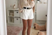 a blush sheer blouse, white high waisted mini shorts, neutral trainers and a black belt