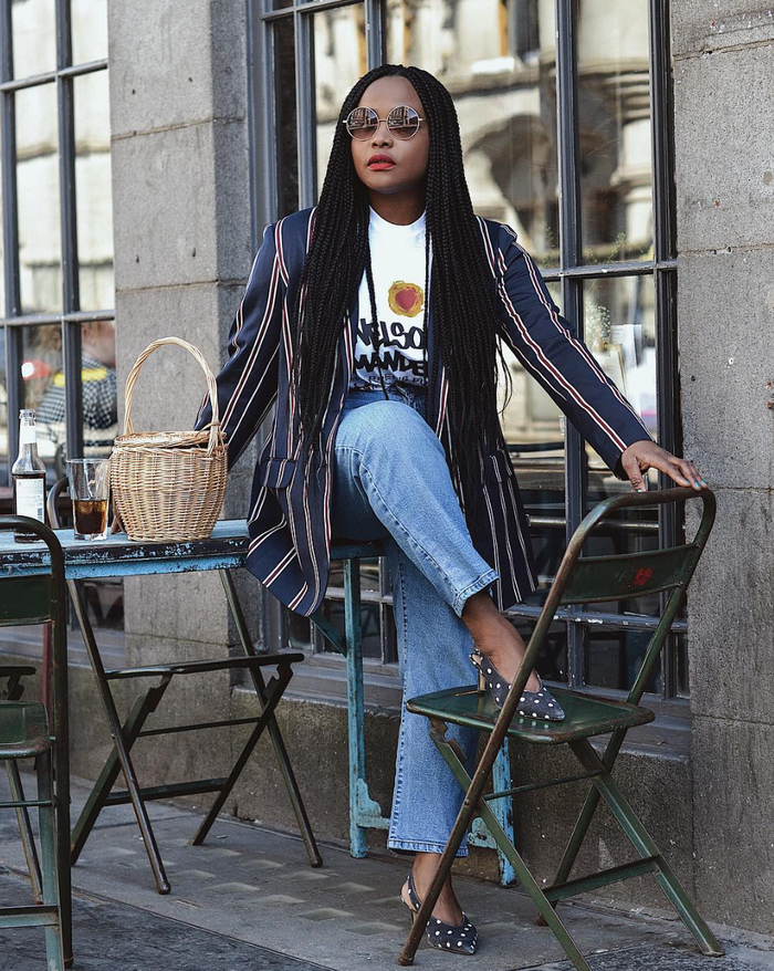 a casual date look with a printed tee, blue jeans, a striped blazer, a basket bag and sunglasses