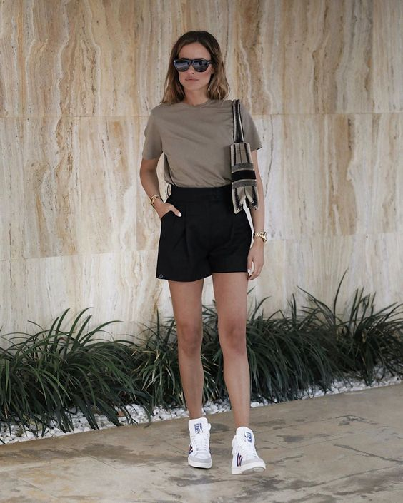 a comfy minimal look with a taupe tee, black mini shorts, white sneakers and a color block bag