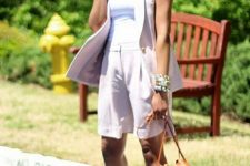 a gorgeous lilac short suit with a waistcoat, Bermuda shorts, a white top, colorful heels and an amber bag