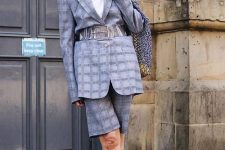 a grey plaid Bermuda short suit with an oversized blazer, a white t-shirt and electric blue heels