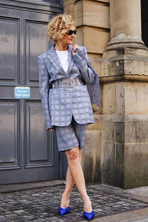 a grey plaid Bermuda short suit with an oversized blazer, a white t shirt and electric blue heels