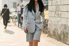 a grey short suit with Bermudas, white sneakers and a bucket hat for an edgy work look