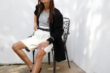 a casual summer look with shorts and a blazer