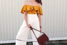a mustard ruffle off the shoulder top, high waisted culottes, white moccasins and a plum-colored bag