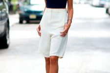 a navy crop top, white high waisted bermuda shorts, black shoes for a hot summer day