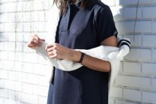 a navy polo mini dress and a white jumper are timeless classics for those summer to fall days