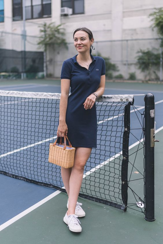 a navy polo mini dress, white sneakers and a woven bag are absolute classics for summer