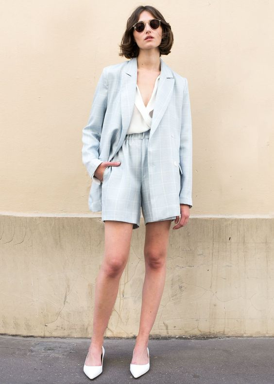 a pale blue windowpane short suit, a white blouse, white shoes for a stylish work look