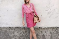 a pink shirt, a pink suede-looking skirt, a tan bag and white shoes plus a handkerchief for summer