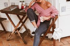 a red gingham off the shoulder wrap blouse with black jeans and black sneakers for a lovely girlish outfit