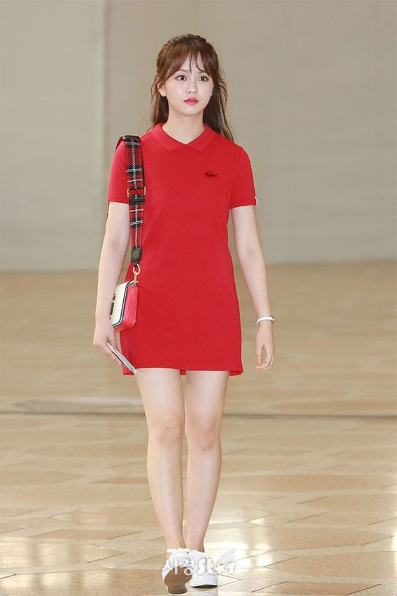 a red polo dress, a mini bag with a plaid strap and white sneakers are a bold summer look