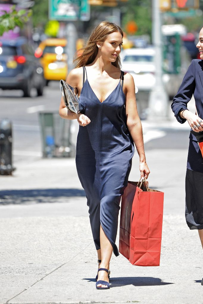 a slate grey slip midi dress with a deep neckline and a front slit, navy shoes and a metallic clutch for a first date