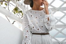 a star cutout blouse, white trousers, a straw hat and a straw bag