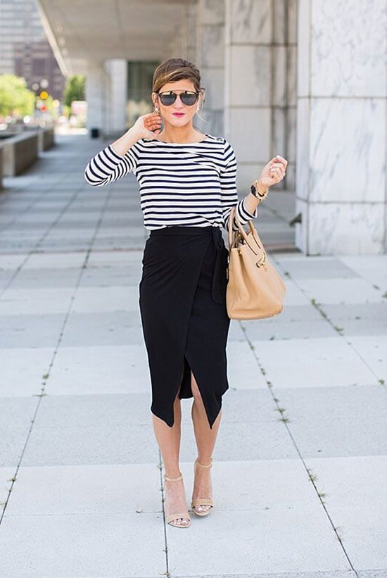 a striped black and white top, a black wrap midi skirt, nude heels and a tan tote for summer