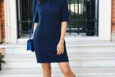 a stylish and simple look with a navy polo dress, white sneakers and a navy crossbody plus large sunglasses are classics