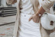 a stylish neutral summer look with a printed tee, a white denim mini, a neutral linen blazer and a white bag