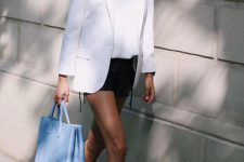 a summer look with a white t-shirt, a white blazer, black mini shorts, white sneakers and a blue bag