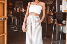 a white bandeau top, striped linen culottes, white block heels and a round woven bag for summer