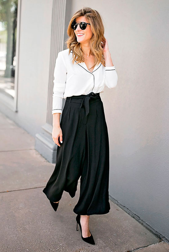 a white pajama style shirt, black paperbag waist culottes and black heels for a non boring look