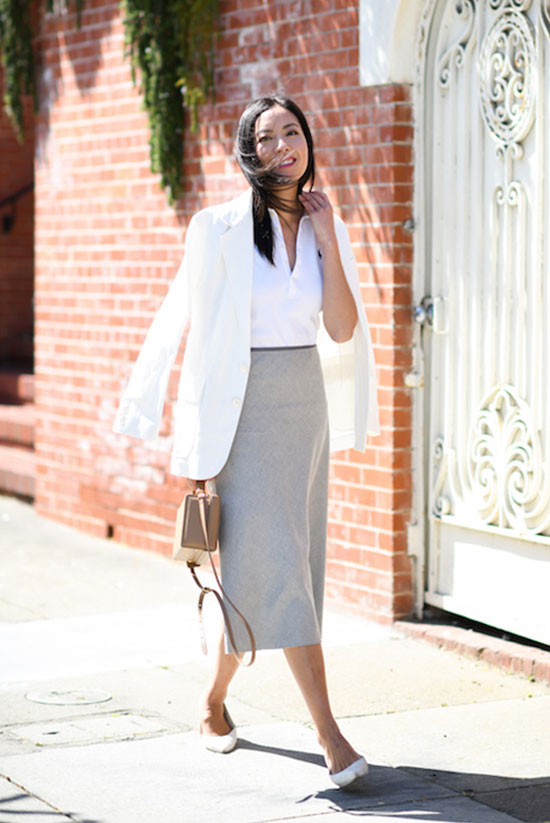 a white polo shirt, a creamy oversized blazer, grey midi skirt, white flats and a tan bag
