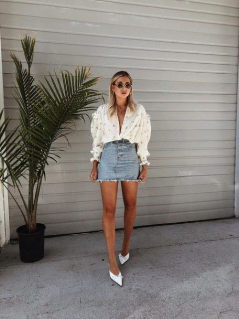a white printed blouse with puff sleeves, a denim mini, white heels and retro-inspired sunglasses